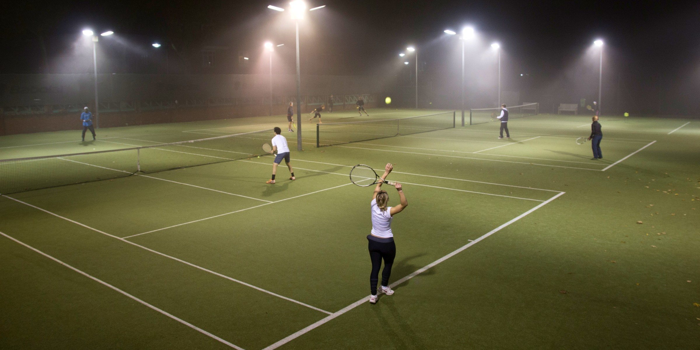 Club's tennis courts by night